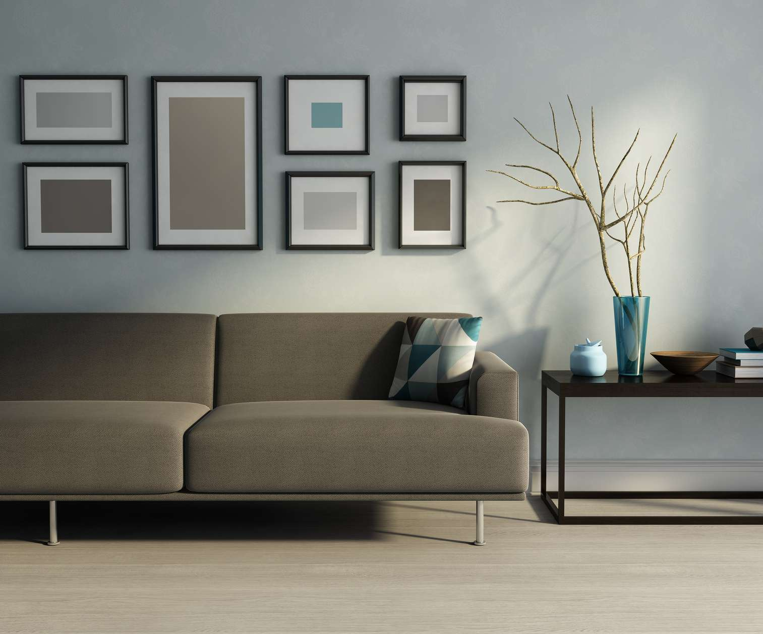 Modern interior, biege sofa, frames and a table